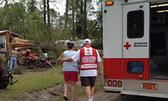 A Red Cross volunteer offers comfort and support to a Beaufort County resident whose home was damaged by the tornadoes.